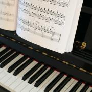 Up-close photo of upright piano.